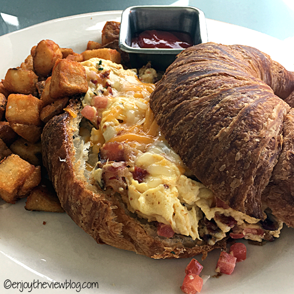croissant with scrambled eggs and fried potatoes