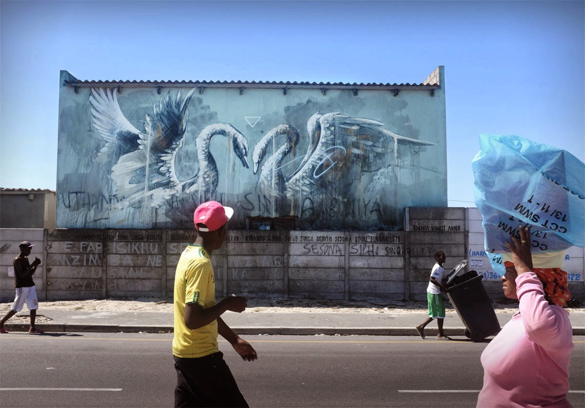 After a beautiful interactive piece last month (covered), Faith47 spent the last few days working on this massive new mural in Cape Town, South Africa.