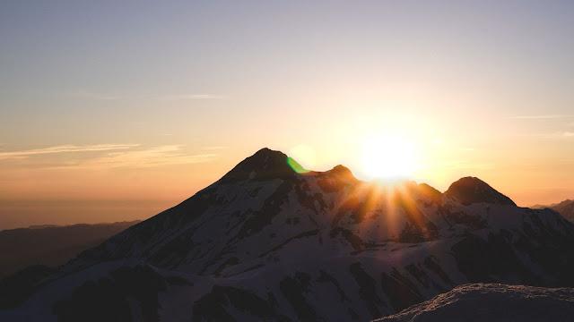Mountain Sunrise Photo by Mary Pokatova on Unsplash