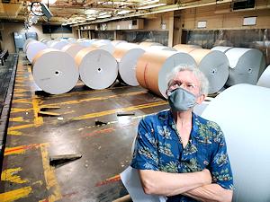 Billy Cox taking one last look at the Herald-Tribune's printing press in Sarasota
