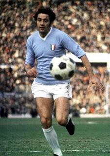 Giorgio Chinaglia, wearing the blue shirt of Lazio. embroidered with the Scudetto