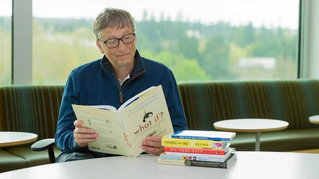 Bill gates reading a book