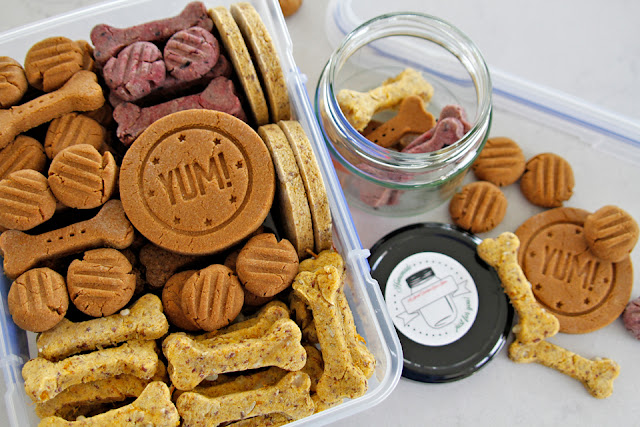 Homemade dog treats in containers for storage