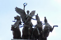 A black angel riding four black horses