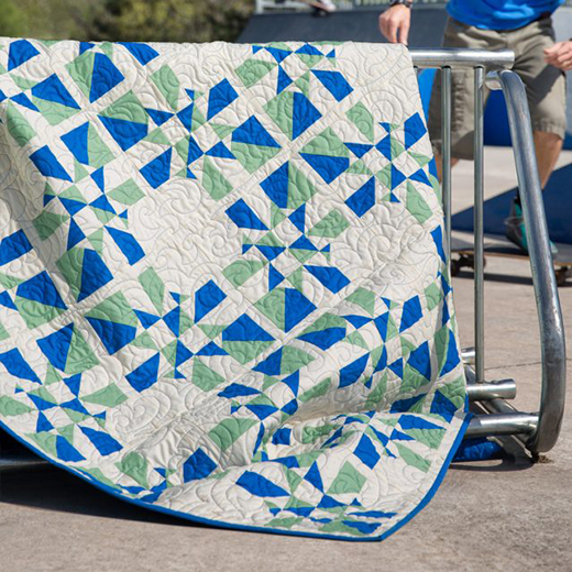 Kindred Pinwheels Quilt Free Tutorial designed by Rob Appell of Man Sewing