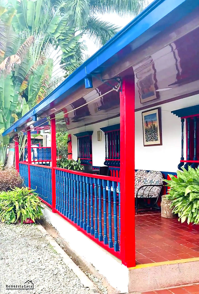 red and blue house with a front porch