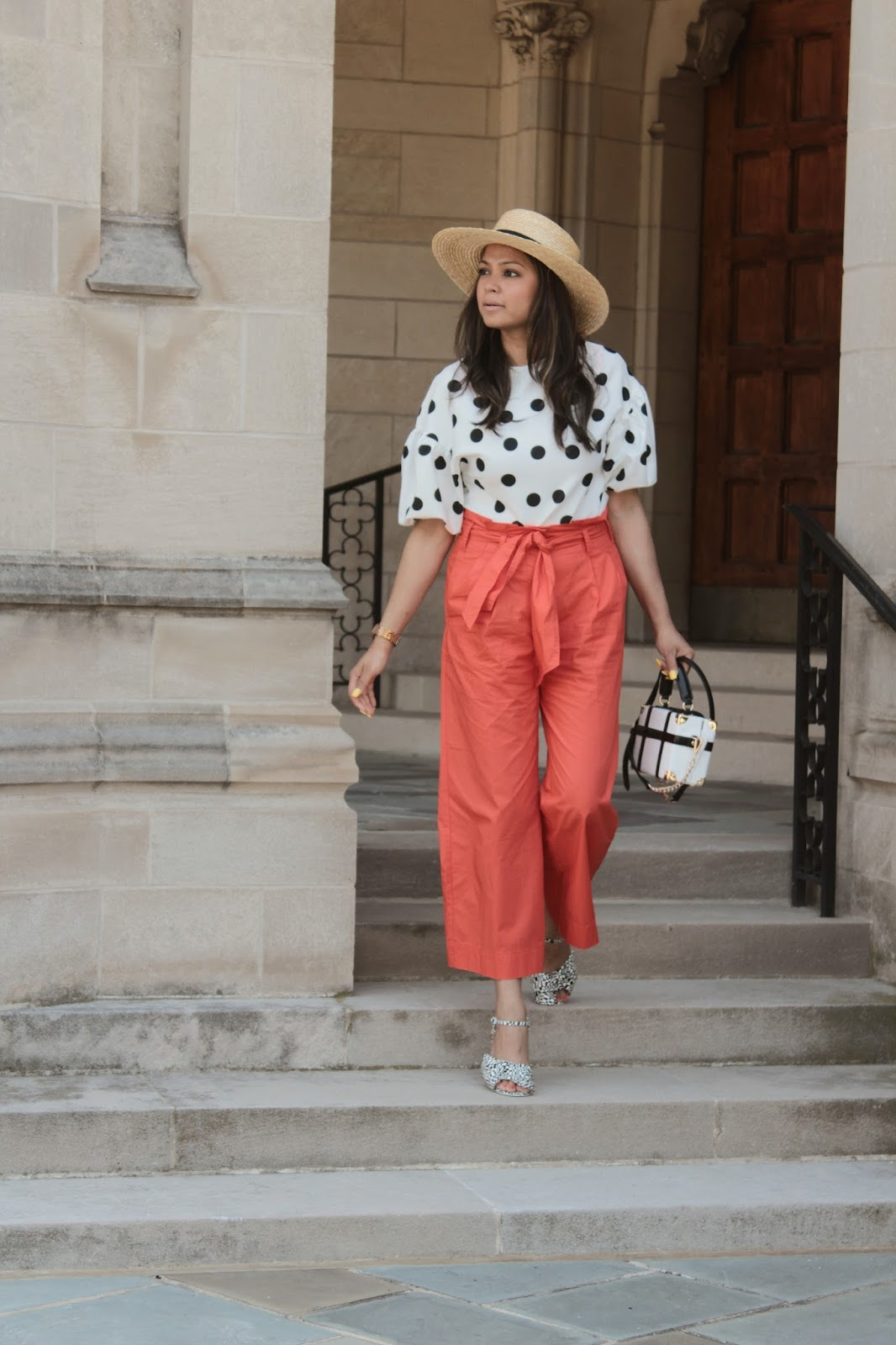 how to wear polka dots, zara puff sleeve blouse, orange paper bag waist pants outfit, printed sandals, white and black, orange trousers, high waisted, boxed bag, myriad musings