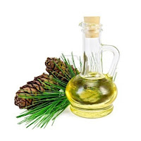 Pine cones, greenery and a bottle full of yellow liquid with a cork stopper - the elements of Cedarwood Oil.