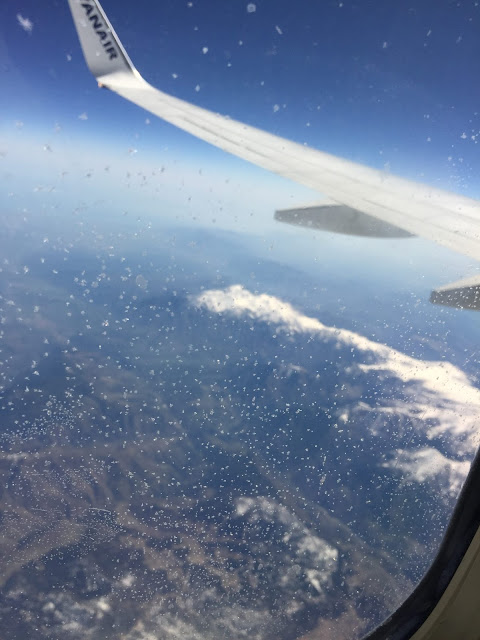 Going on holiday - airplane window photograph