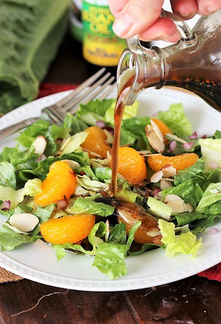 Pouring Asian Sesame Dressing On Salad Image