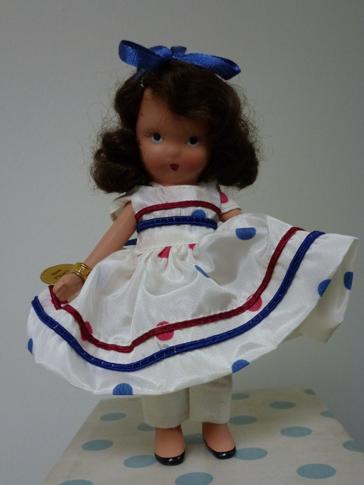 Truly Mint Bisque Doll With Brown Mohair Wig Movable Arms And Frozen Legs White Muslin Pantalets Taffeta Dress Blue Red Dots Trimmed