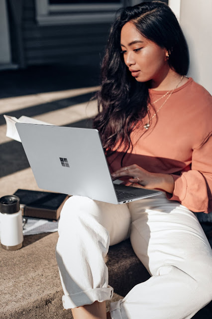 woman looking at laptop:Photo by Windows on Unsplash