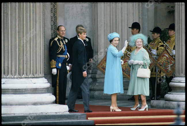 In pale blue and aqua, the Queen and the Queen Mother at the wedding of Prince Charles and Diana Spencer