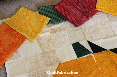 squares of orange, yellow, red, green and cream for a fall quilt by QuiltFabrication
