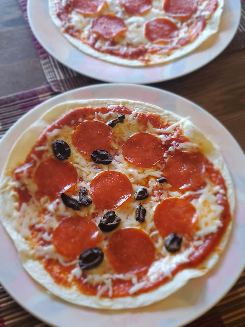 Pizzas with tortilla wrap crusts and pepperoni and black olives