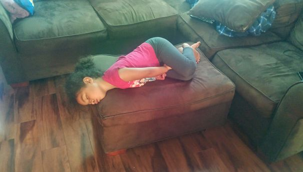 15+ Hilarious Pics That Prove Kids Can Sleep Anywhere - Napping On The Ottoman