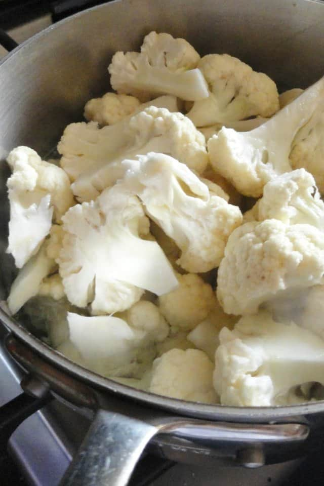 Chopped Cauliflower in pan with water.