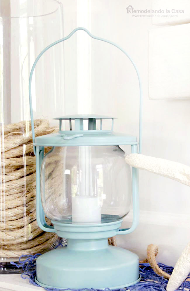 blue lamp, clear vase with rope inside