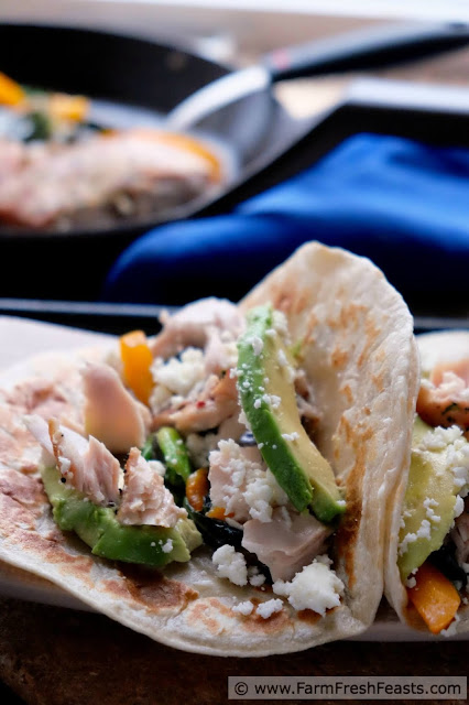 Flakes of seasoned fish set against sautéed bok choy and peppers in a warm tortilla, topped with avocado slices and crumbled queso. Use the farm share in unexpected ways with these tacos.