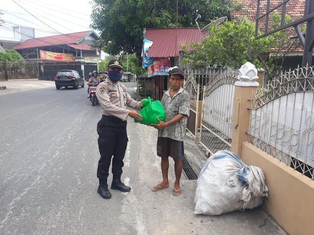 Polda Jambi Berikan Sembako di 11 Kecamatan di Kota Jambi Yang Terdampak Covid-19