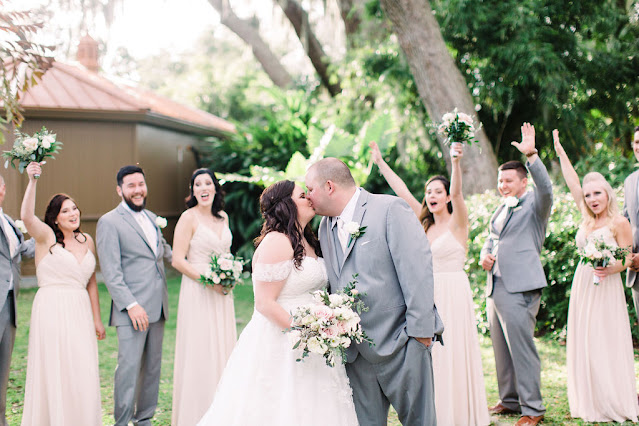 Beige wedding party celebration photo; groomsmen and bridesmaids
