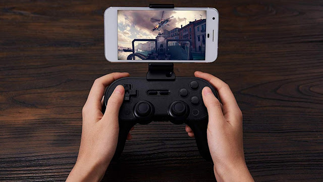 Sn30 Pro + مع قبضة هاتف مثبتة.