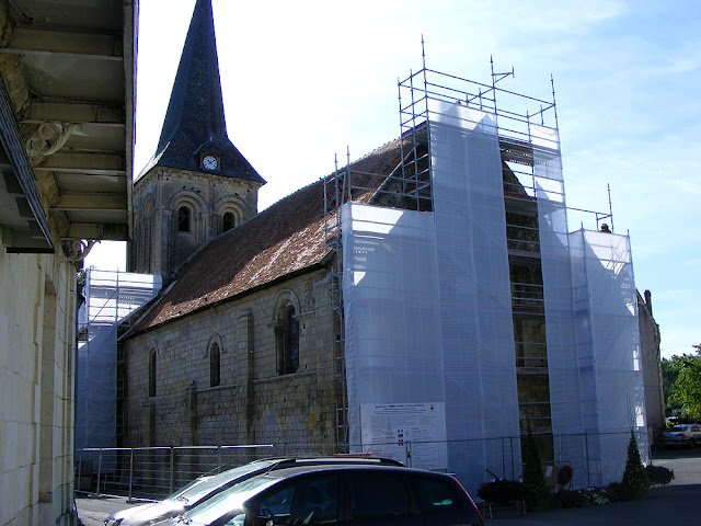 The church at La Celle Guenand under scaffolding for restoration.  Indre et Loire, France. Photographed by Susan Walter. Tour the Loire Valley with a classic car and a private guide.