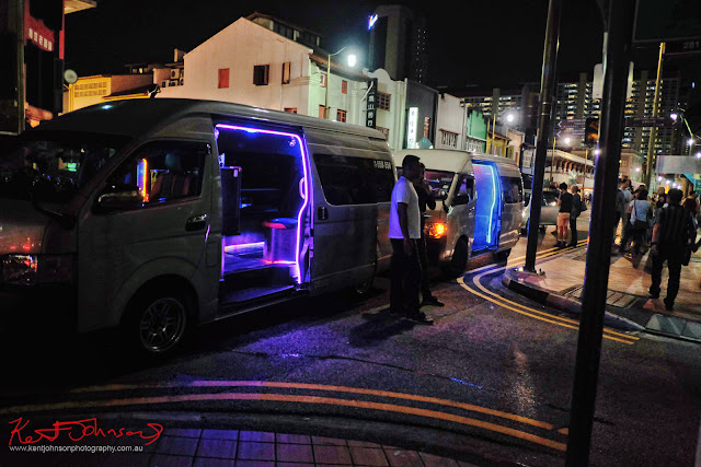 Neon lit limo-taxis on South Bridge Road Singapore -  Photo by Kent Johnson for Street Fashion Sydney.