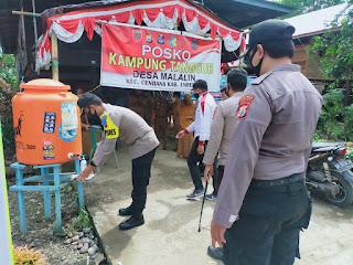 Kapolres Enrekang Mengunjungi Posko Kampung Tangguh di Desa Malaling
