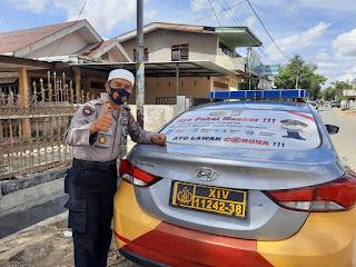 Polsek Tellu Siattinge Branding Mobil Patroli dengan Imbauan Cegah Covid-19