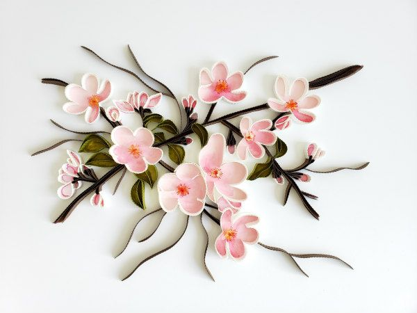 delicate pink quilled paper blossoms and branches