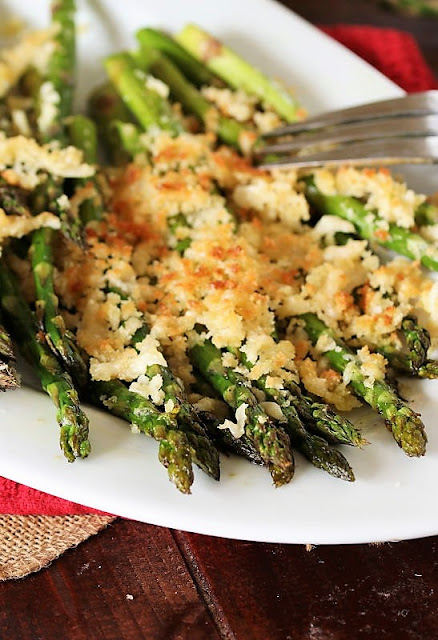 Plate of Roasted Asparagus with Crunchy Parmesan Topping Image
