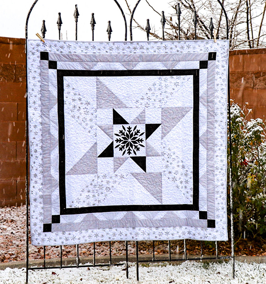 Sparkle Winter Storm Quilt designed by Carol of Just Let Me Quilt for Riley Blake Designs
