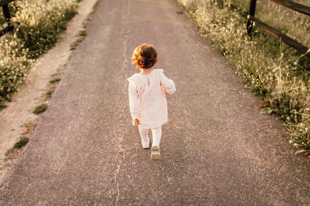 little girl walking on her own