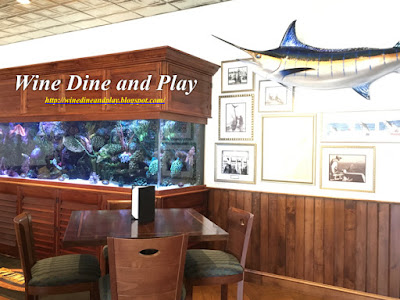 The cocktail lounge with mini aquarium at the RumFish Grill in St. Pete Beach, Florida