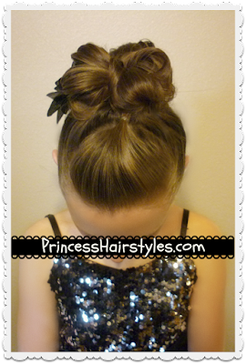 Pretty and edgy hairstyle for dance. Messy bun faux hawk tutorial.