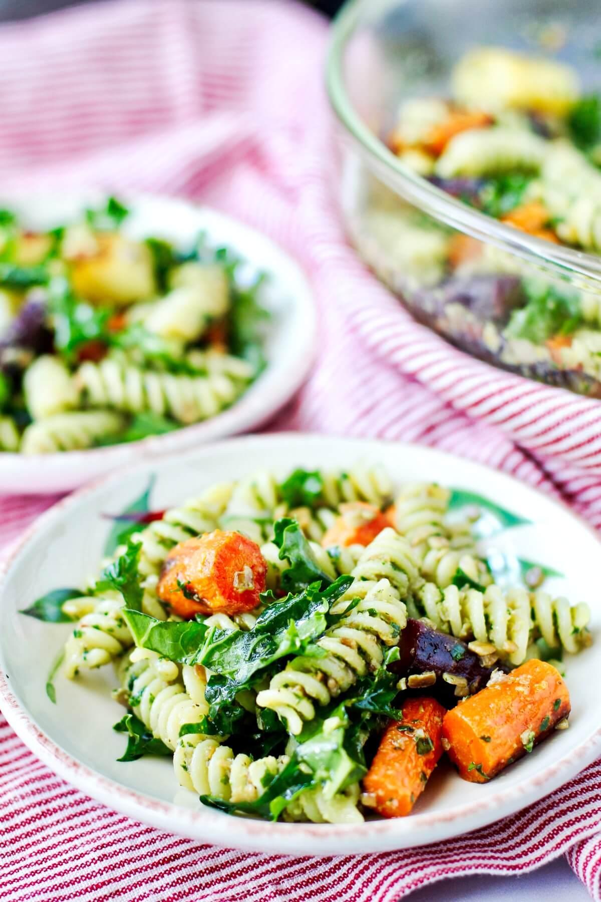 Roasted carrot pasta salad on plates