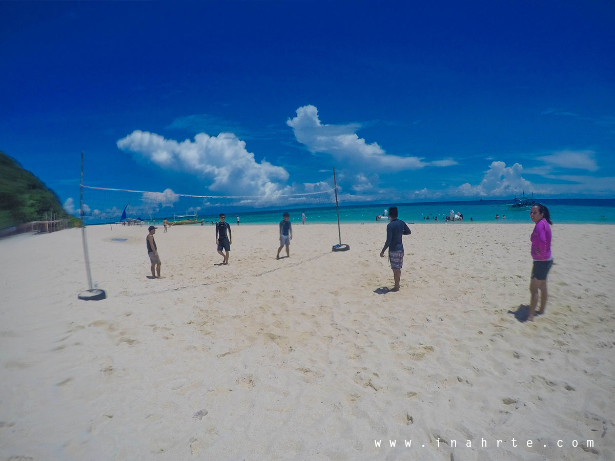 Playing volleyball at Puka Beach, Boracay