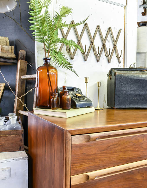 MCM Huntely dresser styled with vintage decor