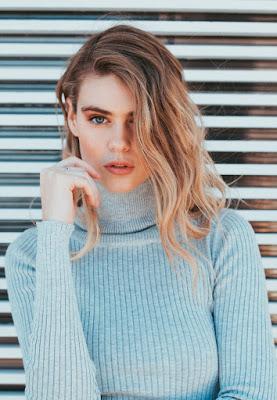 woman wearing blue sweater