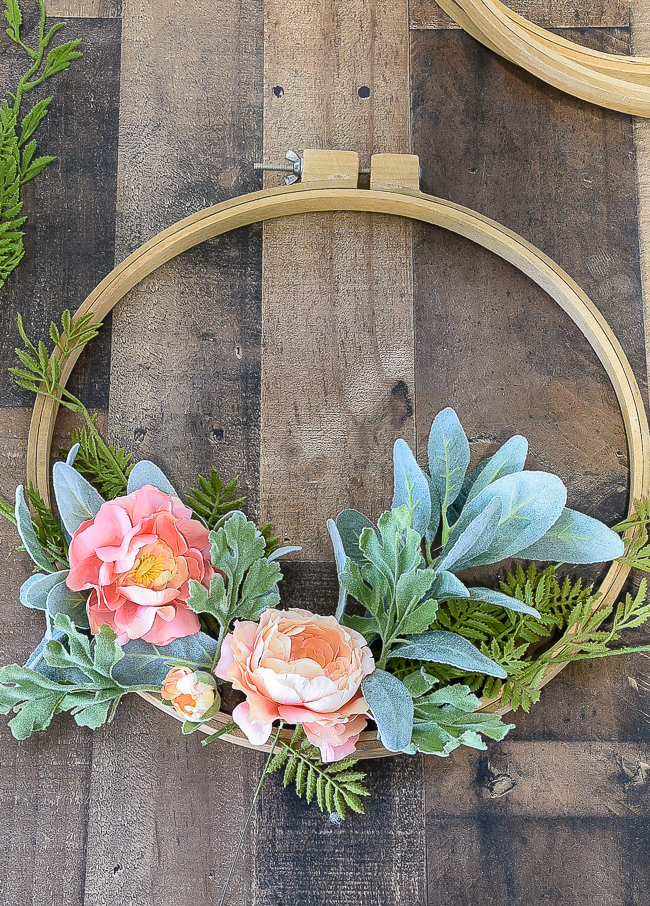 laying out flowers on quilt hoop wreath