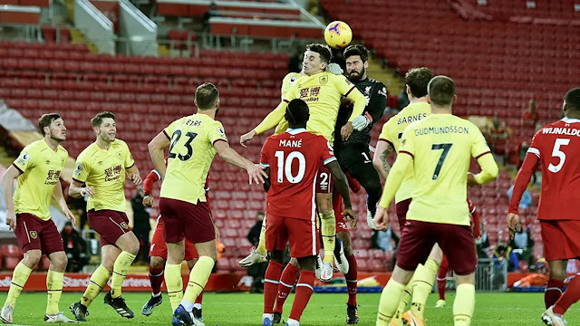 Liverpool goal keeper Alison Becker challenges for a header against Burnley