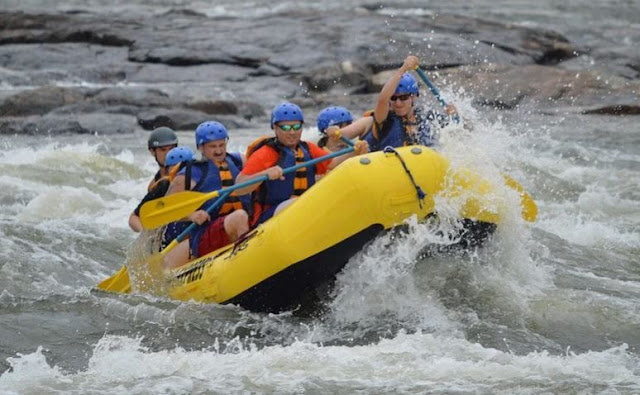 planning team building actiity try white water rafting build employee camaraderie