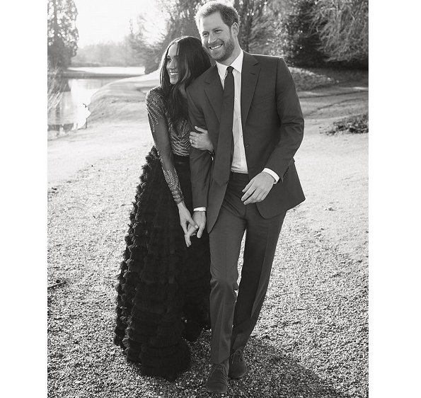 Kensington Palace released two engagement photos of Prince Harry and Meghan Markle. What Meghan wore.