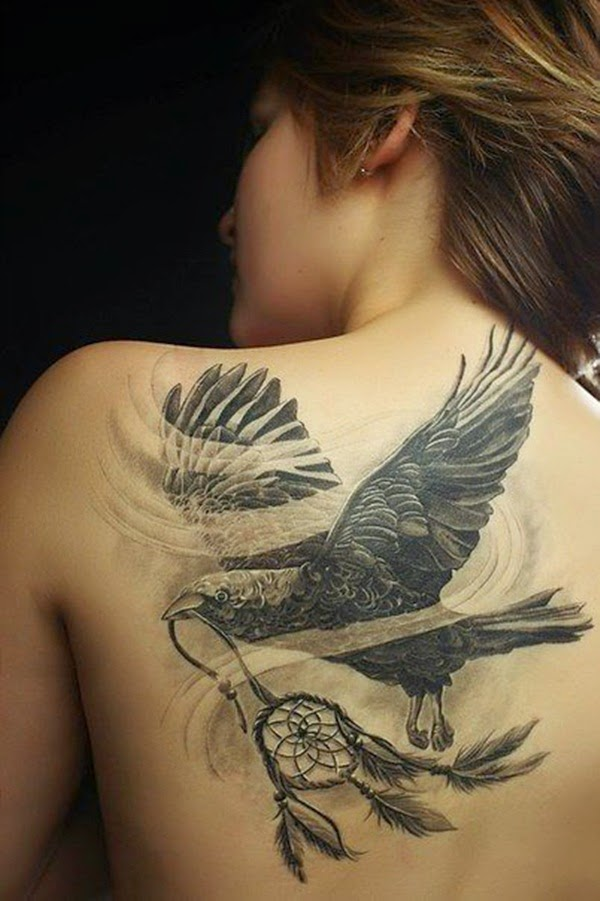 Bird with dreamcatcher on back. Excellent combination tattoo!