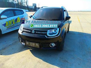 Ekspedisi FARHIYAtrans mengirim mobil Suzuki Ignis dari Surabaya tujuan ke Medan dengan car carrier dan driving, estimasi perjalanan 6 hari.