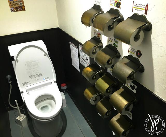 toilet, a dozen toilet paper