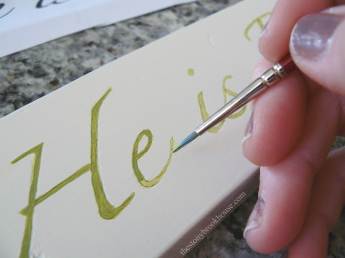 Painting letters on wood
