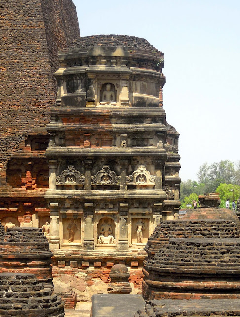 A tower with stucco figures of the Buddha near the Sariputta stupa at Nalanda