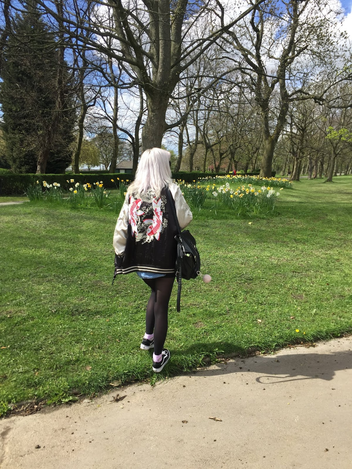 Silver haired girl wearing souvenir Jacket, vans and vintage denim shirt